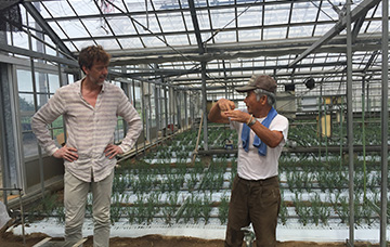 Japanese grower discussing start of the trail
